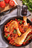 Chicken leg cooked with red sauce Stock Image
