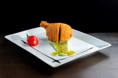 Chicken leg in a cover. Royalty Free Stock Images