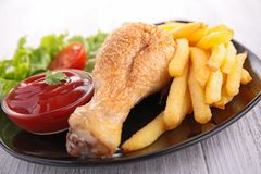 Chicken leg and french fries Stock Photography