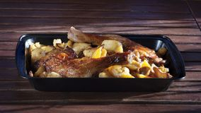 Chicken leg with fried potatoes. Fast food, Fast food, fried potatoes and grilled chicken leg Stock Photography