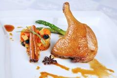 Chicken leg with fruit salad Stock Photo