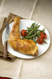 Chicken leg with green beans and cherry tomatoes Royalty Free Stock Photos
