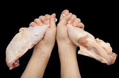 Chicken leg in hand on a black background.  Royalty Free Stock Photos