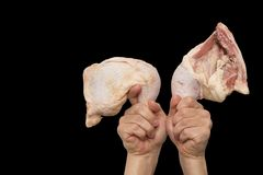 Chicken leg in hand on a black background.  Royalty Free Stock Images