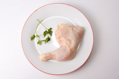 Chicken leg with parsley Royalty Free Stock Photos