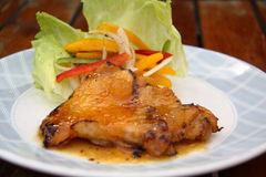 Chicken leg with peach sauce Stock Photography