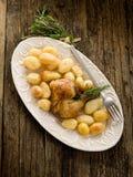 Chicken leg with potatoes Stock Photos