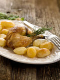 Chicken leg with potatoes Stock Photo