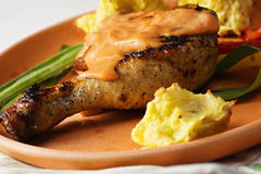 Chicken leg with potatoes closeup Royalty Free Stock Image