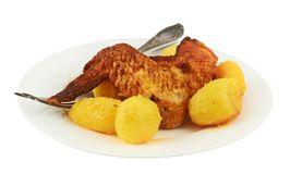 Chicken leg with potatoes in a plate Stock Images