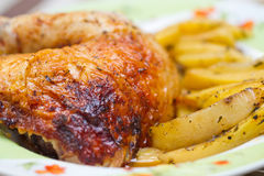 Chicken leg with potatos Royalty Free Stock Photography