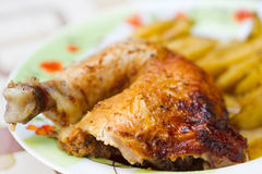 Chicken leg with potatos Stock Images