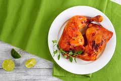 Chicken Leg Quarters On White Plate Royalty Free Stock Images