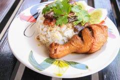 Chicken leg with rice. A chicken leg with rice Stock Photography