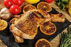 Chicken leg roasted with oranges stock image