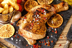 Chicken leg roasted with oranges stock photo