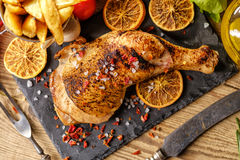 Chicken leg roasted with oranges stock images