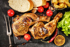 Chicken leg roasted with oranges royalty free stock photos