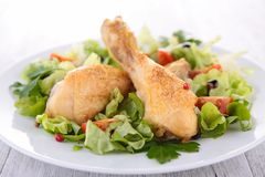 Chicken leg and salad Royalty Free Stock Photo