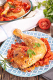 Chicken leg and tomato sauce Royalty Free Stock Photography