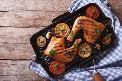Chicken leg and vegetables on the grill pan. horizontal top view Royalty Free Stock Image