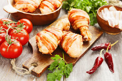 Chicken leg wrapped in bacon Royalty Free Stock Photography