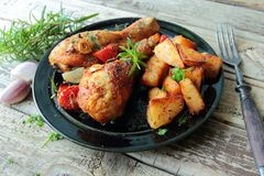 Chicken lega with potatoes chips Stock Photography