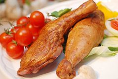 Chicken legs. Roasted chicken legs with vegetables close up Royalty Free Stock Photos