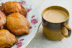 Chicken legs. Fried chicken legs and cup of coffee Stock Images