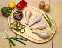 Chicken Legs. On Cutting board Stock Photo
