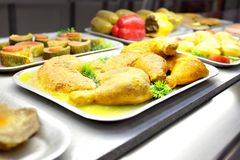 Chicken legs. Tray with cooked chicken legs in dining room royalty free stock photography
