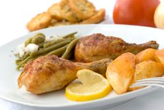 Chicken legs with asparagus Stock Photos