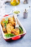 Chicken legs. Baked chicken legs with fresh basil leaves royalty free stock image
