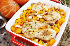 Chicken legs baked with pumpkin and garlic Royalty Free Stock Photos