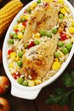 Chicken legs baked with rice and vegetables Stock Photography