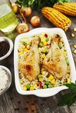 Chicken legs baked with rice and vegetables Stock Photos