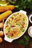 Chicken legs baked with rice and vegetables Royalty Free Stock Photography
