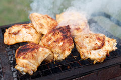 Chicken legs being fried on grill Royalty Free Stock Images