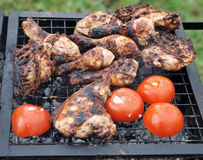 Chicken legs being smoked on grill stock photos