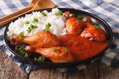 Chicken legs with chilli sauce Sriracha and Rice close-up. horiz Royalty Free Stock Photo