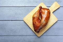 Chicken legs, cooked on a grill on a cutting board on a wooden table. Copy space. Top view stock images