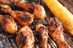 Chicken legs and corn on grill Royalty Free Stock Photo