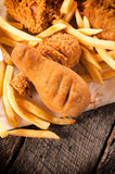 Chicken legs and french fries Royalty Free Stock Images
