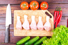 Chicken legs fresh, greens, vegetables Royalty Free Stock Images
