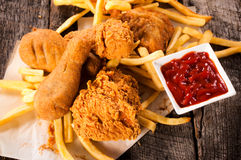 Chicken legs fried. Deep fried chicken legs on the table,from above Stock Image