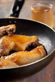 Chicken legs fried in a non stick pan Stock Image
