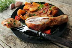 Chicken legs with fried potatoes Royalty Free Stock Photos