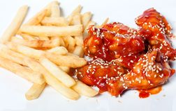 Chicken legs and fries. In  tomato sauce Royalty Free Stock Photos