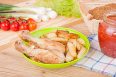 Chicken legs and fries on the plate Royalty Free Stock Photography
