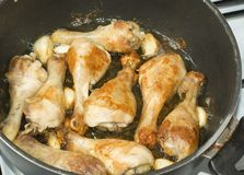 Chicken legs with garlic Stock Photos